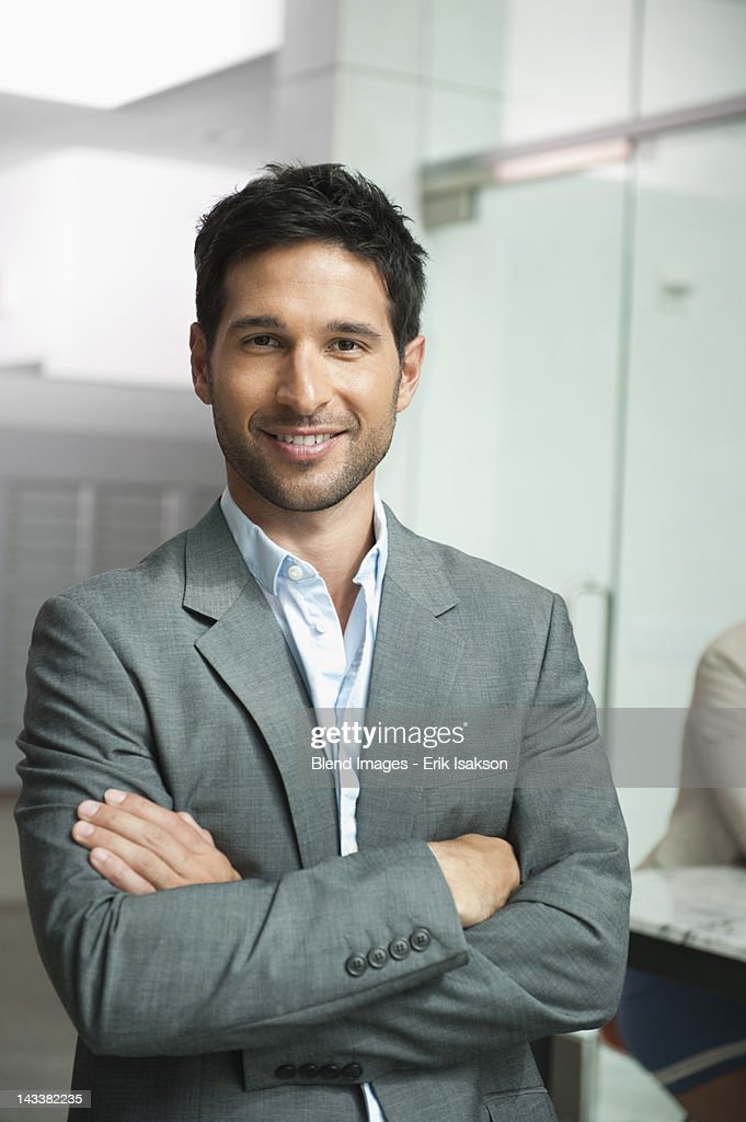 Smiling mixed race businessman : Stock Photo
