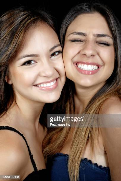 Smiling mixed race friends
