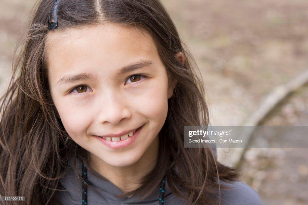 Smiling mixed race girl : Stock Photo