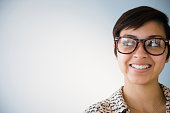 Smiling mixed race woman wearing eyeglasses