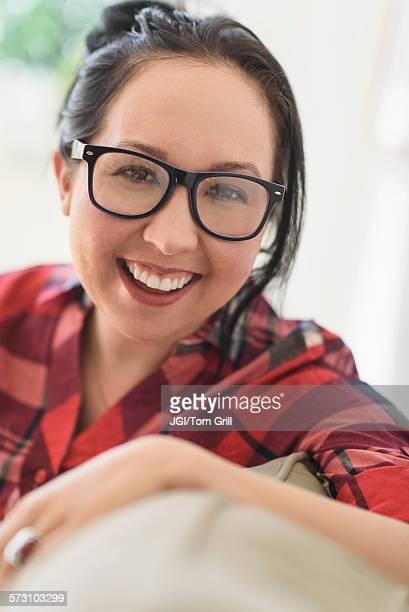 Smiling mixed race woman wearing eyeglasses