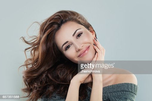 Smiling Model Woman with Red Curly Hair : Foto stock