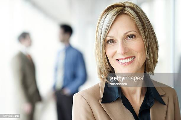 Smiling modern executive businesswoman