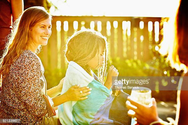 Smiling mom with son during neighborhood party