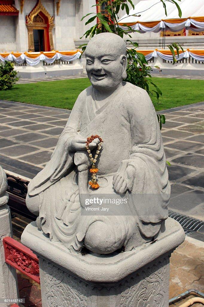 Smiling monk statue Wat Benchamabophit temple Bangkok Thailand : Photo