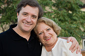 Smiling mother and adult son