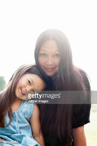Smiling mother and daughter looking at camera : Stock Photo