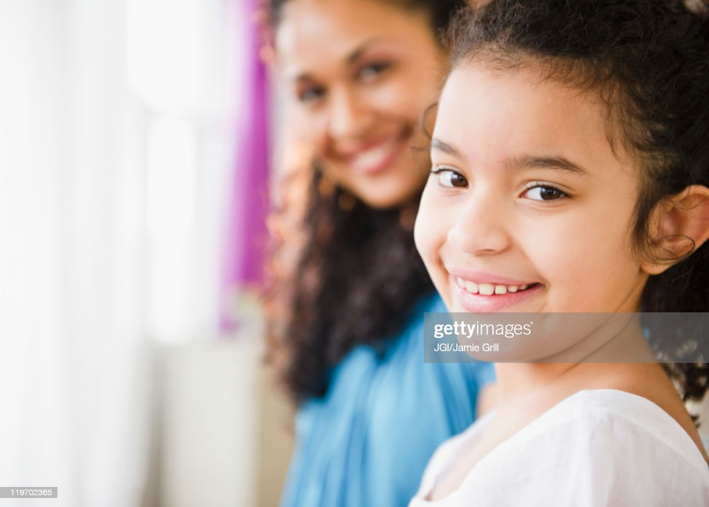 Smiling mother and daughter : Stock Photo