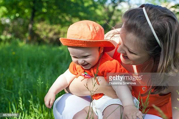 Smiling mother hugging her daughter