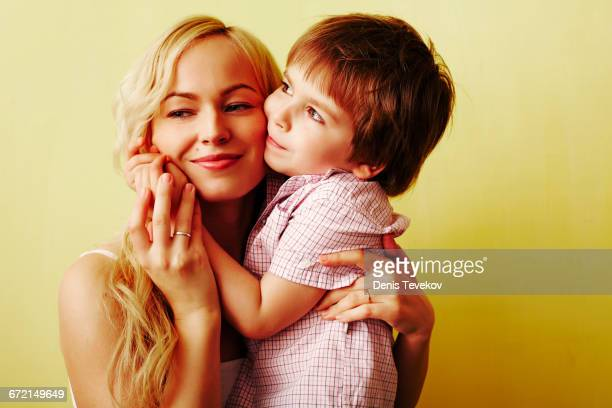 Smiling mother hugging son