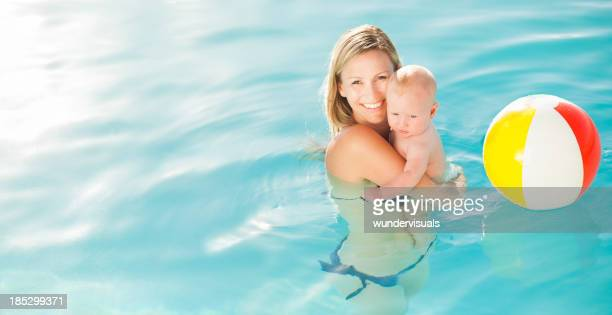Smiling Mother With Baby In Swimming Pool