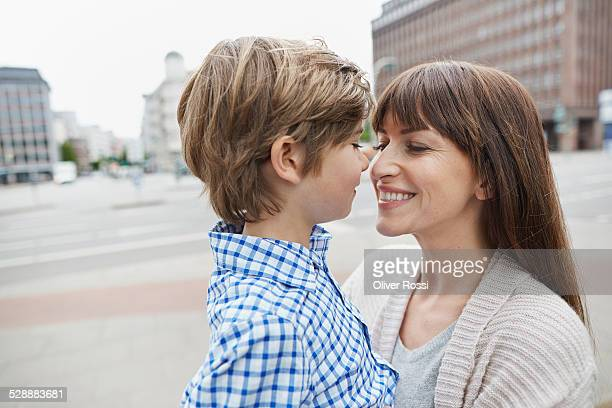 Smiling mother with son outdoors