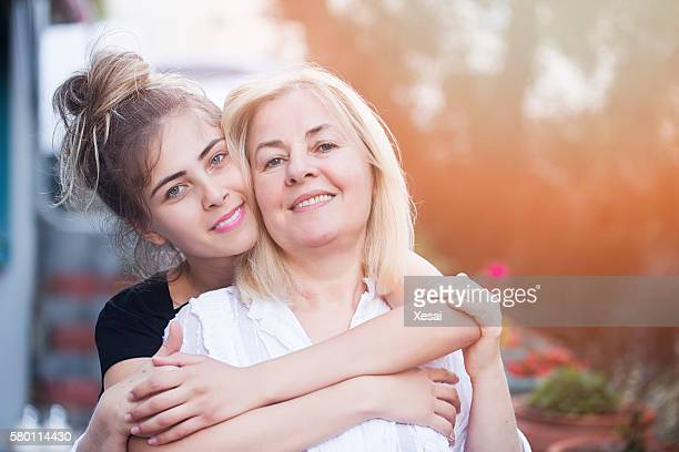 Smiling mother with young daughter