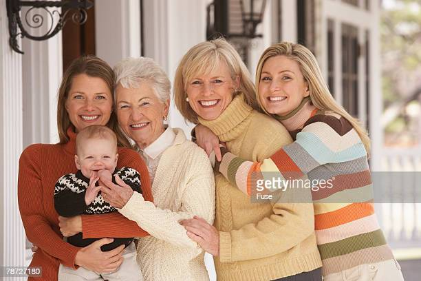 Smiling Mothers, Daughters, and Baby Boy