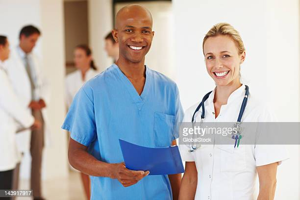 Smiling multi racial doctors