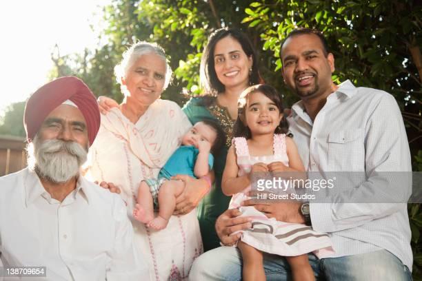 Smiling multi-generation Asian family
