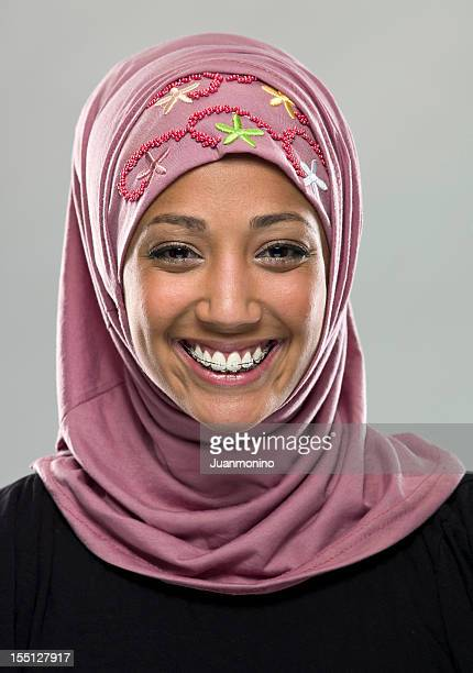 Smiling muslim girl with braces