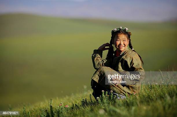 Smiling nomadic girl with flowers in her hair
