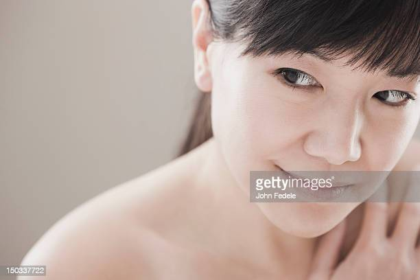 Smiling, nude Asian woman