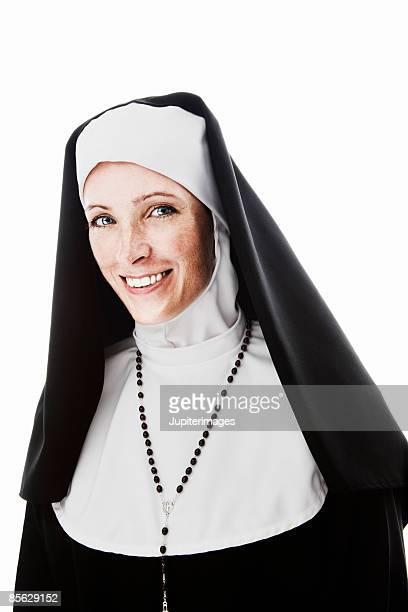 Smiling nun wearing rosary