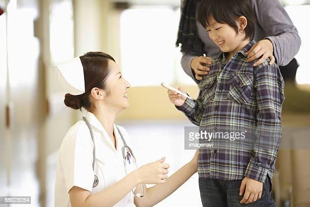 Smiling nurse and a boy