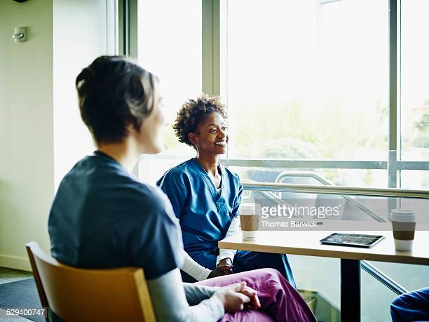 Smiling nurse in employee lounge with colleagues