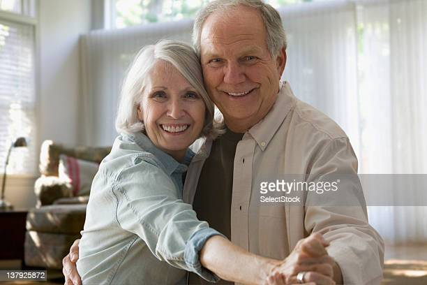 Smiling older couple dancing
