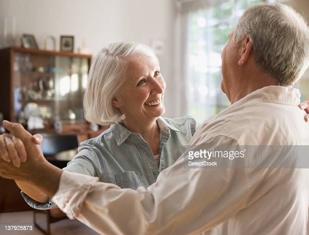 Smiling older couple dancing