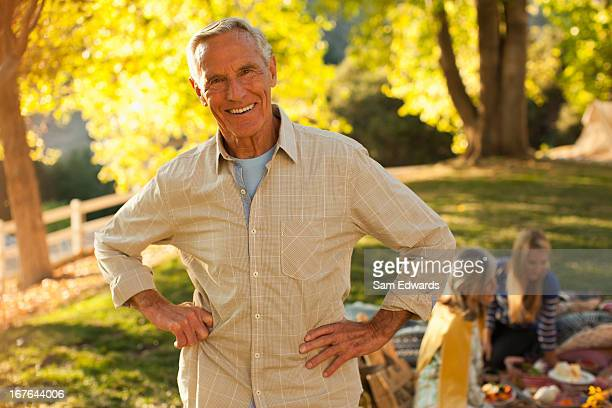 Smiling older man standing outdoors