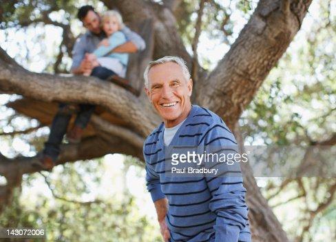 Smiling older man walking outdoors : Stock Photo