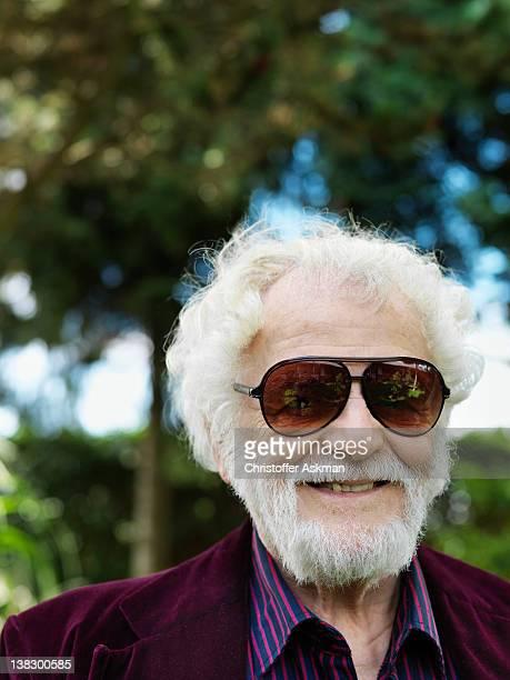 Smiling older man wearing sunglasses