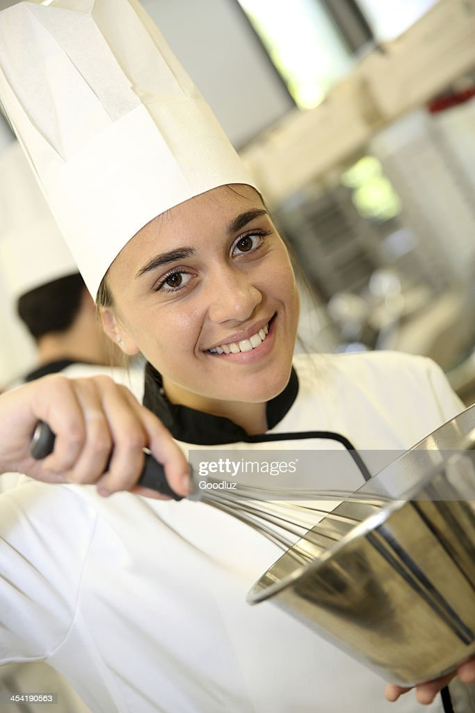Smiling pastry cook with whip : Stock Photo