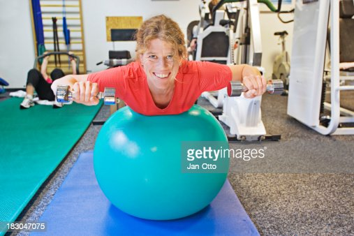 Smiling patient with dumbbell