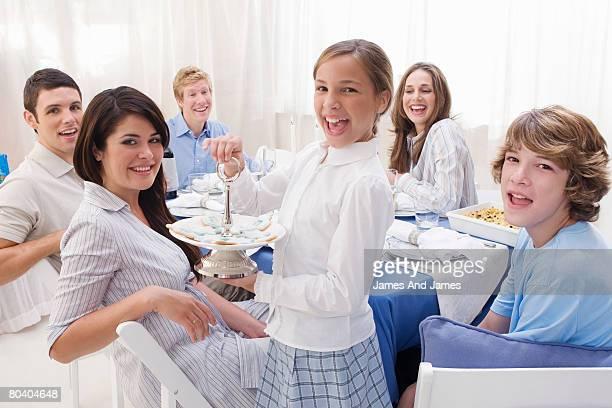 Smiling people at Hanukkah gathering