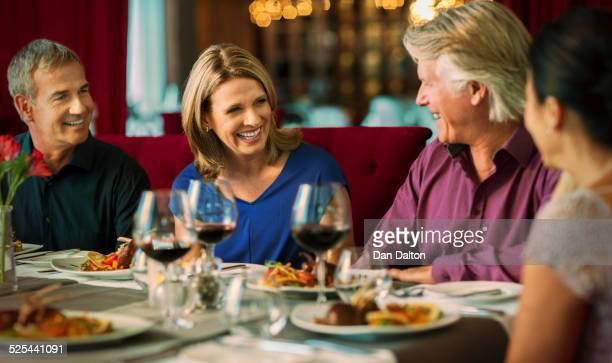 Smiling people enjoying their meal in restaurant