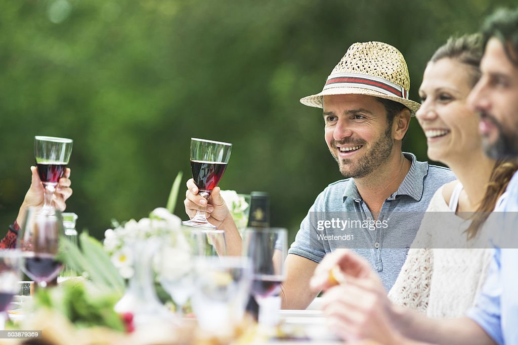 Smiling people on a garden party