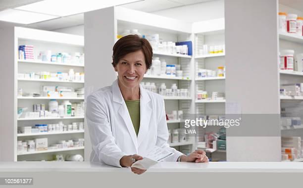 Smiling Pharmacist Holding Medication