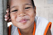 Portrait of a smiling boy in the Philippines from an impoverished neighborhood.
