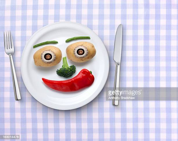Smiling plate of vegetables on gingham