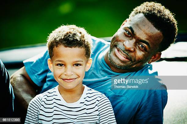 Smiling portrait of father and young son