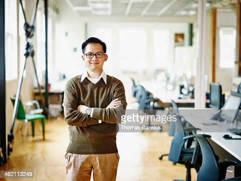 Smiling professional in high tech office