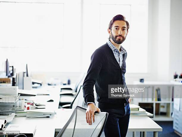 Smiling professional standing at workstation