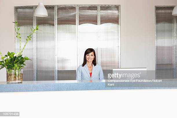smiling professional woman sitting at a desk