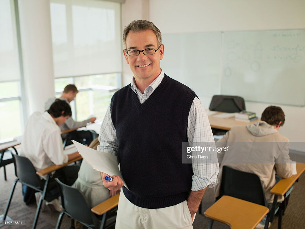 Smiling professor in classroom