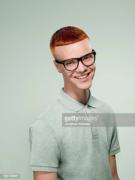 Smiling red hair male with glasses on