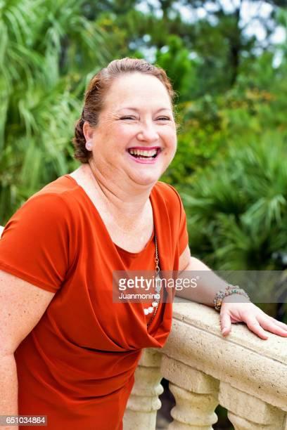 Smiling redhead mature woman
