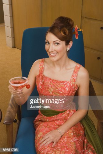 smiling retro woman holding cocktail stock foto getty images. Black Bedroom Furniture Sets. Home Design Ideas