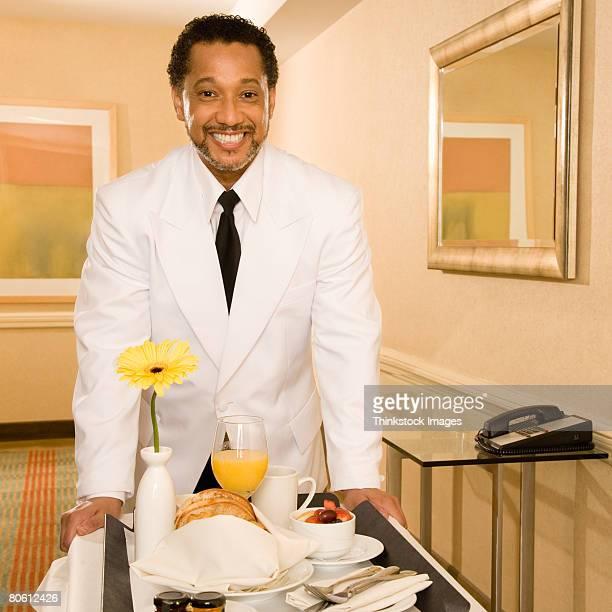 Smiling room service waiter