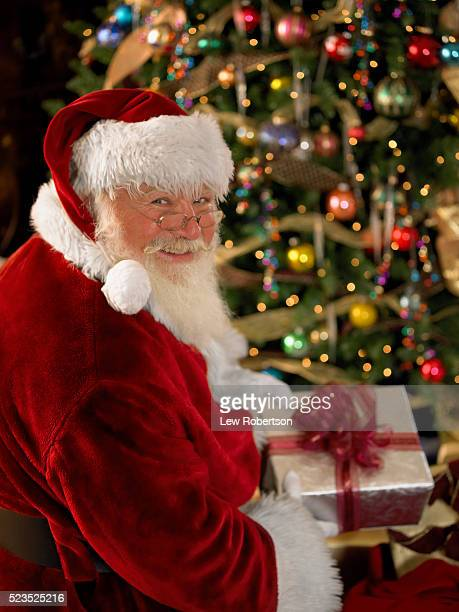 Smiling Santa Claus Bringing Presents