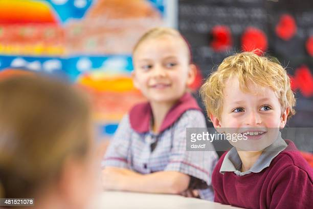 Smiling School Children Learning in the Classroom